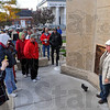 Tribune-Star/Jim Avelis<br /> Recording memories: Brenda Robinson takes a photo of her husband James in front of the relocated Viet Nam memorial after re-dedication ceremonies were over.
