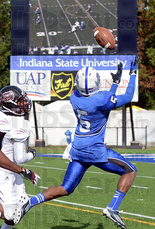 Jumbo play: Indiana State defender #5, Calvin Burnett is about to get his second interception of the game against two Missouri State receivers. He's visible making the play on the Jumbotron in the background.