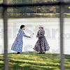 Pioneers: Two young children dressed in period costumes play near the pioneer village at Fowler Park Saturday during the annual Fowler Park Pioneer Days  event.