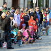 Tribune-Star/Jim Avelis<br /> The loot: Children scramble for candy tossed by homecoming parade participants Saturday morning.