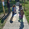 Tribune-Star/Jim Avelis<br /> Born active: Diana Sinclair of Vigo County Head Start watches over some of her charges as they use the newly opened Born Learning Trail in Collett Park.
