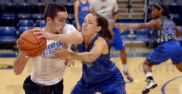 """Tribune-Star/Joseph C. Garza<br /> Joey says """"be aggressive!"""": Indiana State's Taylor Whitley, right, doesn't give a member of the practice squad any room to move during team practice Monday at Hulman Center."""