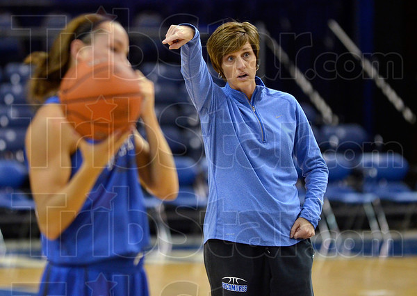 Tribune-Star/Joseph C. Garza<br /> Xs and Os: Indiana State University women's basketball coach Teri Moren explains a play to her team during team practice Monday at Hulman Center.