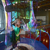 Tribune-Star/Jim Avelis<br /> Huffing and puffing: Mackenzie Adams blows from the inside of her soap bubble at the Terre Haute Children's Museum Thursday afternoon. She was there as part of the Exceptional Explorations program of Bridges of Indiana.