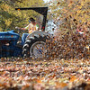 Tribune-Star/Jim Avelis<br /> Blowing in the wind: Terre Haute Parks Department employee Patrick Beeghly uses a power blower to move fallen leaves into the middle of Ohio Boulevard tree row Wednesday afternoon. Crews will bring mowers there today to mulch the leaves.