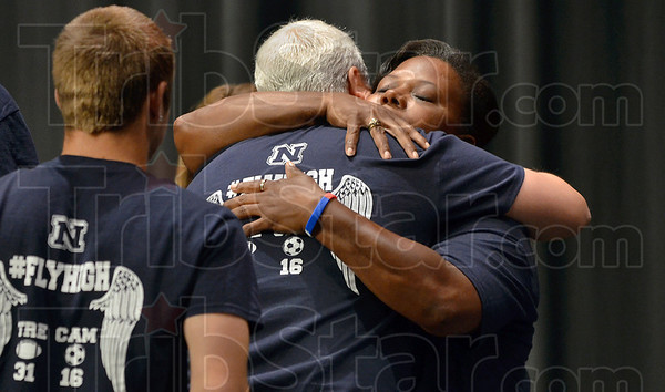 Tribune-Star/Joseph C. Garza<br /> For Tre and Cam: Karen Johnson, the mother of the late Tre Fletcher, hugs Mark Taylor, the father of the late Cam Taylor, after a press conference to announce the donation of funds in the name of the two students Wednesday at Terre Haute North High School.