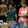 Tribune-Star/Joseph C. Garza<br /> So many to choose from: Jane Hadley of Sackrider & Co. looks over the gift basket raffle items before the start of the Power of the Purse live auction Wednesday at Hulman Center.