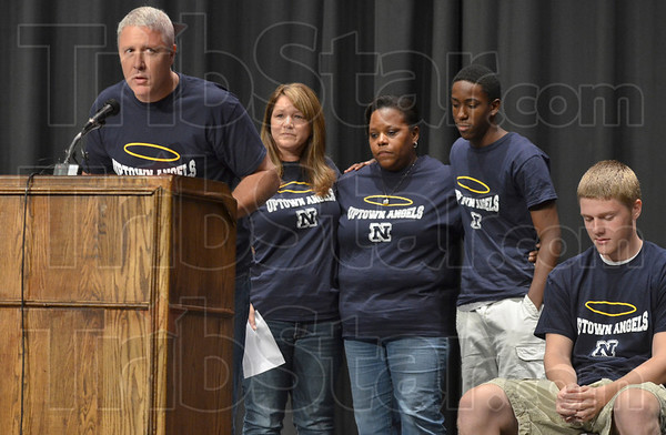 Tribune-Star/Joseph C. Garza<br /> Thank you: Mark Taylor, the father of the late Cam Taylor, expresses his and his family's thanks for the support they have received during a press conference Wednesday at Terre Haute North High School. Behind, Taylor is his wife, Tracie Taylor, who stands next to Karen Johnson and Benjamin Fletcher, the family of the late Tre Fletcher, with senior Jon Kiefer at far right.