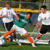 Tribune-Star/Jim Avelis<br /> My ball: Vincennes Lincoln forward Eric Ramirez keeps control of ball between Terre Haute South defenders Forrest Pommier and Ryan Abrams.