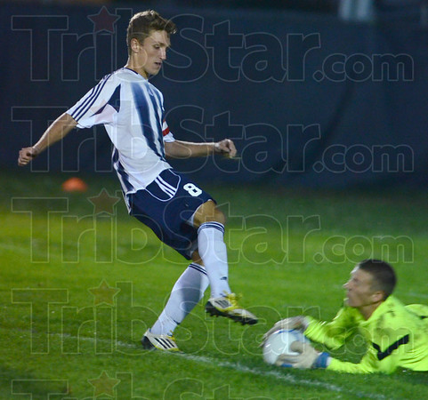 Tribune-Star/Jim Avelis<br /> Saved: Terre Haute North forward Kaden Slaon holds back on his kick as Northview goal keeper Chandler Reeves grabs the ball.