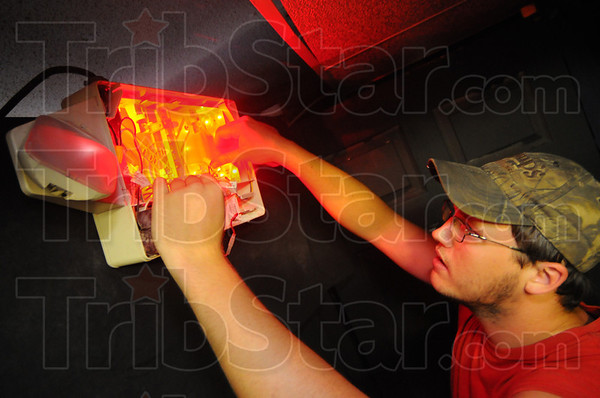 Tribune-Star/Jim Avelis<br /> And there was light: Brett Payne hooks up lights for Linton's Frightmares Haunted House. The legendary  Sammy Terry will once again be on hand.