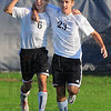 Tribune-Star/Jim Avelis<br /> We got one: Ryan Abrams(6) and Rush Sommerville rejoice after Sommerville's first half goal tied the score in the Braves match with Vincennes Lincoln.