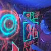 Tribune-Star/Jim Avelis<br /> Black and light: Kegan Inman spray paints finishing touches in one of the rooms of his Frightmares Haunted House in Linton. The legendary Sammy Terry will be on hand again this year for the event.