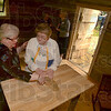 Tribune-Star/Joseph C. Garza<br /> How St. Mother Theodore Guerin lived: Sisters of Providence Jan Craven and Kay Kelly feel the texture of the altar in the new Log Cabin Chapel Wednesday after the dedication and blessing of the structure at St. Mary-of-the-Woods.