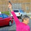 "Tribune-Star/Jim Avelis<br /> Practice: Phyllis Koszewski fires off a ""banger"" during the orientation meeting of the Terre Haute Crow patrol Monday evening in the Courthouse parking lot."