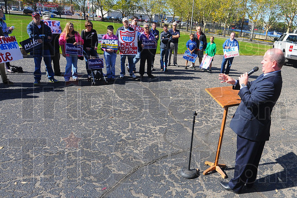Tribune-Star/Jim Avelis<br /> Welcome: U.S. Representative Larry Buschon R-8, addresses a small gathering of people attending an early voting rally on the Indiana State University campus.