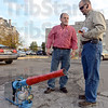 Tribune-Star/Jim Avelis<br /> More power: Jack Robinson, Facilities Manager for UAP clinic talks with Matt Christie about the propane cannon used to keep crows away from their buildings.