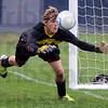Tribune-Star/Jim Avelis<br /> Busy night: Owen Valley goal keeper Josh Parker can't get to a ball in first half action Monday night in the first game of the soccer sectionals at Terre Haute North.