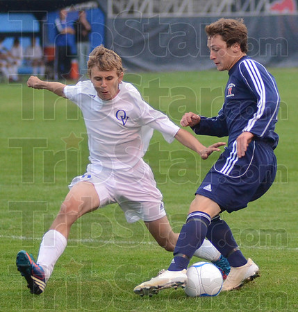 Tribune-Star/Jim Avelis<br /> Quick stop: Owen Valley defender Trevor Hege overruns the ball as Terre Haute North forward Jacob Parham puts on the brakes. The action was in the first game of the Patriots soccer sectionals