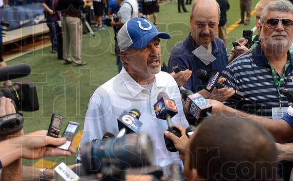 Looking forward to the season: Indianapolis Colts coach Chuck Pagano talks to the media after the team's open practice Wednesday at Lucas Oil Stadium in Indianapolis.