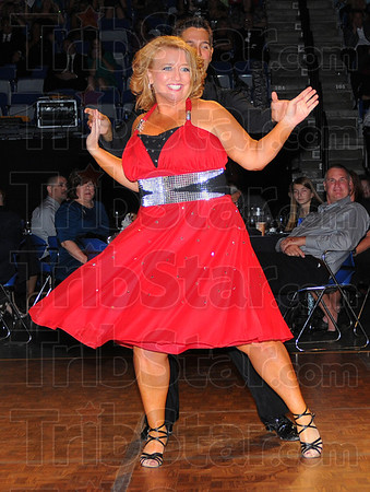 Tribune-Star/Jim Avelis<br /> Dancin' the night away: Amy Anderson of First Financial Bank was the top fundraiser in Dancing With the Terre Haute Stars last Friday night. Her dance partner is Brandon Halleck.