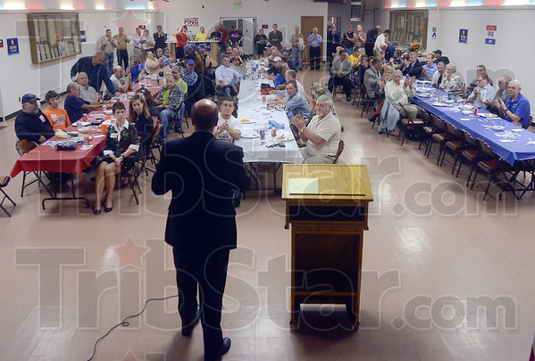 Tribune-Star/Joseph C. Garza<br /> Campaign stop: Democratic candidate for Indiana governor John Gregg, center,  receives a round of applause as he addresses the attendees of a candidate forum Monday at the Labor Temple.