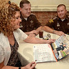 Tribune-Star/Joseph C. Garza<br /> She knows Mr. January: Missy Hopper looks at the photo of her husband, Vigo County Sheriff's Deputy Larry Hopper, who is featured for the month of January in the new United Way of the Wabash Valley calendar. The Hoppers and fellow deputy Sean Trevarthan were checking out the new calendar Tuesday at the Saratoga Restaurant.