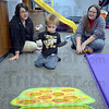 Tribune-Star/Jim Avelis<br /> Skills: Xander Rowell tosses bean bags while Union hospital therapist Mandy Higginbotham and his mom Kylee watch.