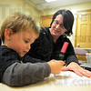 Tribune-Star/Jim Avelis<br /> Just fine: Xander Rowell practices his fine motor and visual motor skills with the help of Union Hospital therapist Mandy Higginbotham.