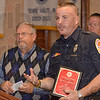 Tribune-Star/Joseph C. Garza<br /> What started it all: Terre Haute firefighter David Simpson describes how his interest in firefighting began after he took a class at Indiana State University about the profession during a ceremony to honor him Tuesday at the Holiday Inn.