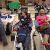 Tribune-Star/Joseph C. Garza<br /> Life saver: Indiana State University freshman Kelsey Griswold, center, of Attica nears completion of her donation during a homecoming blood drive Tuesday in the Hulman Memorial Student Union. At right is fellow student, Karma Eberhardt, 19, of Kokomo who was waiting to start the process.