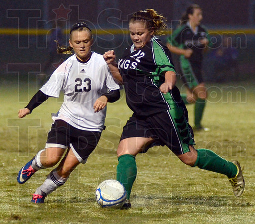 Tribune-Star/Jim Avelis<br /> No give: South Vermilion sophomore Kaci Mack contends for possesson with West Vigo's Mackenzie Collins in first half action of their sectional soccer matchup.