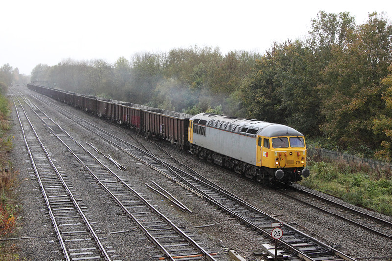 31 October 2012 :: In wet dull weather that necessitated an ISO setting of 1250, 56312 passes Hinksey with 6Z91 from Calvert to Didcot Power Station