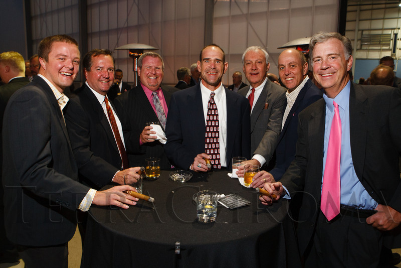 Andy Morman, Mark Footer, John Griffin, Dave Sneed, John Wann, Jeb Baum, and Andy Wann.  The 12th Annual Men For The Cure dinner, hosted by the University of Colorado Hospital Foundation Board of Directors and benefiting the Diane O'Connor Thompson Breast Center at University of Colorado Hospital, held at the X Jet terminal, Centennial Airport, in Englewood, Colorado, on Tuesday, Oct. 16, 2012.<br /> Photo Steve Peterson