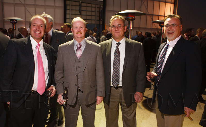 Mark Chavez, Tom Davis, John Morrow, and Steven Millette.  The 12th Annual Men For The Cure dinner, hosted by the University of Colorado Hospital Foundation Board of Directors and benefiting the Diane O'Connor Thompson Breast Center at University of Colorado Hospital, held at the X Jet terminal, Centennial Airport, in Englewood, Colorado, on Tuesday, Oct. 16, 2012.<br /> Photo Steve Peterson