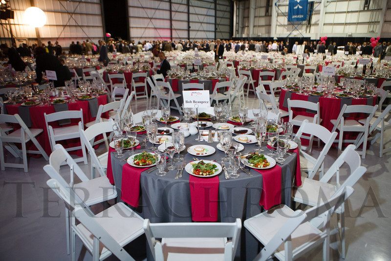 Dining setup inside the X Jet hangar.  The 12th Annual Men For The Cure dinner, hosted by the University of Colorado Hospital Foundation Board of Directors and benefiting the Diane O'Connor Thompson Breast Center at University of Colorado Hospital, held at the X Jet terminal, Centennial Airport, in Englewood, Colorado, on Tuesday, Oct. 16, 2012.<br /> Photo Steve Peterson