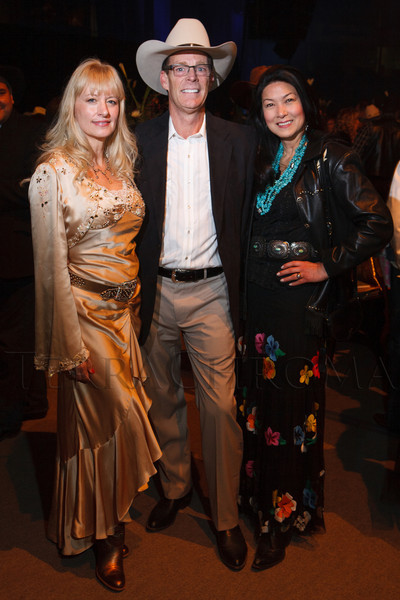 "Kris Lamers (in Sue Wong), Hugh Muñoz, and Wendy Weil.  The 19th annual Western Fantasy gala, themed ""Stars Over the Rockies, Legends of the West,"" a benefit for the Colorado branch of Volunteers of America, at the National Western Events Center in Denver, Colorado, on Saturday, Oct. 20, 2012.<br /> Photo Steve Peterson"