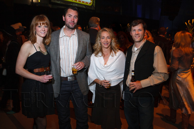 "Abby Springer (Anthropology dress), Jamison McIlvain (Armani coat, Sheplers Western Wear for the rest), with Susan Aldridge, and Jevin Croteau (cq) in clothes from Rockmount.  The 19th annual Western Fantasy gala, themed ""Stars Over the Rockies, Legends of the West,"" a benefit for the Colorado branch of Volunteers of America, at the National Western Events Center in Denver, Colorado, on Saturday, Oct. 20, 2012.<br /> Photo Steve Peterson"