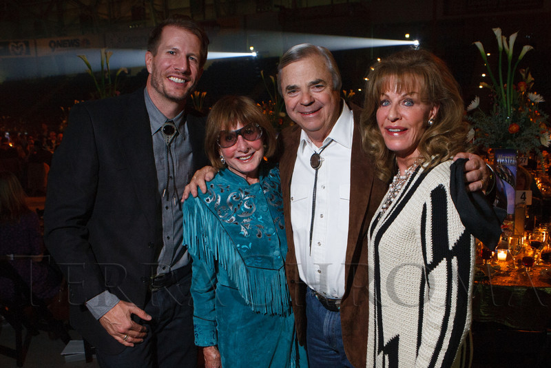 """Scott Coors, Phyllis Coors, and Bob and Kalleen Malone.  The 19th annual Western Fantasy gala, themed """"Stars Over the Rockies, Legends of the West,"""" a benefit for the Colorado branch of Volunteers of America, at the National Western Events Center in Denver, Colorado, on Saturday, Oct. 20, 2012.<br /> Photo Steve Peterson"""