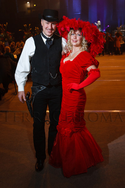 "John and Laura (as Mae West) Nachbur.  The 19th annual Western Fantasy gala, themed ""Stars Over the Rockies, Legends of the West,"" a benefit for the Colorado branch of Volunteers of America, at the National Western Events Center in Denver, Colorado, on Saturday, Oct. 20, 2012.<br /> Photo Steve Peterson"