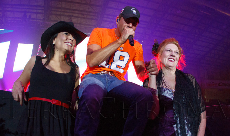 """Rosa March, Rodney Atkins (while performing), and Dixie.  The 19th annual Western Fantasy gala, themed """"Stars Over the Rockies, Legends of the West,"""" a benefit for the Colorado branch of Volunteers of America, at the National Western Events Center in Denver, Colorado, on Saturday, Oct. 20, 2012.<br /> Photo Steve Peterson"""