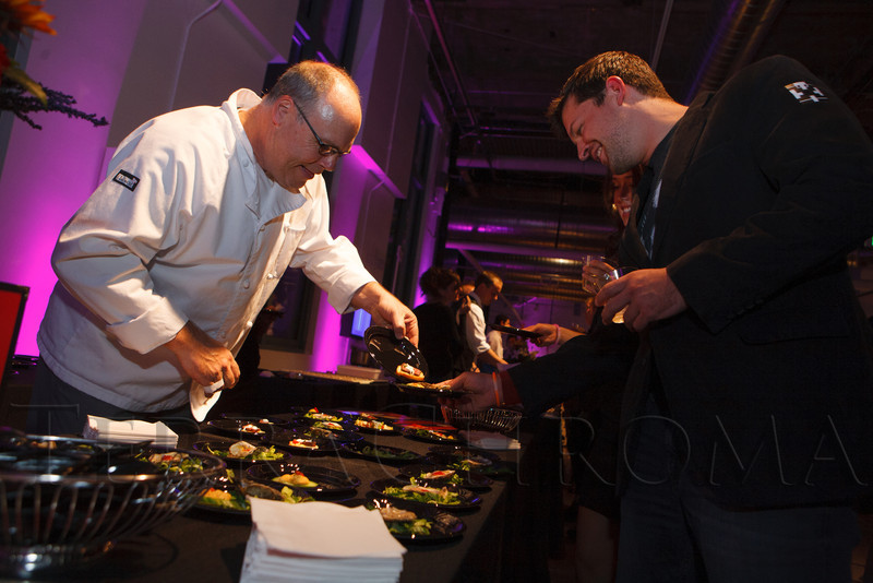"Chef Sean Kelly with LoHi Steakbar.  LIGHT gala, a ""Grand Re-opening Party"" for the McNichols Building, hosted by Civic Center Conservancy and Arts & Venues Denver, at McNichols Civic Center Building in Denver, Colorado, on Wednesday, Oct. 24, 2012.<br /> Photo Steve Peterson"