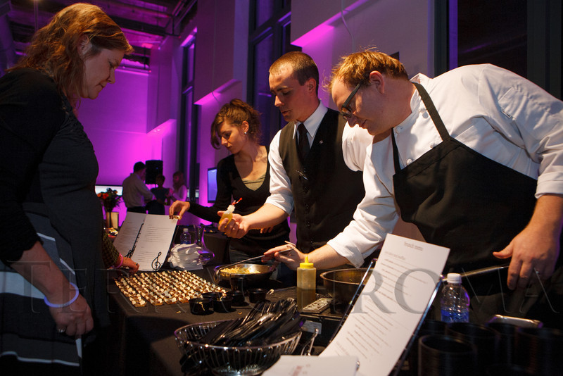 "Laura Frigo, Jordan Kennedy, and Sean McGaughey, with Aria wine bar and Opus restaurant, serve white cheddar agnolotti with onion broth, plus a chocolate treat.  LIGHT gala, a ""Grand Re-opening Party"" for the McNichols Building, hosted by Civic Center Conservancy and Arts & Venues Denver, at McNichols Civic Center Building in Denver, Colorado, on Wednesday, Oct. 24, 2012.<br /> Photo Steve Peterson"