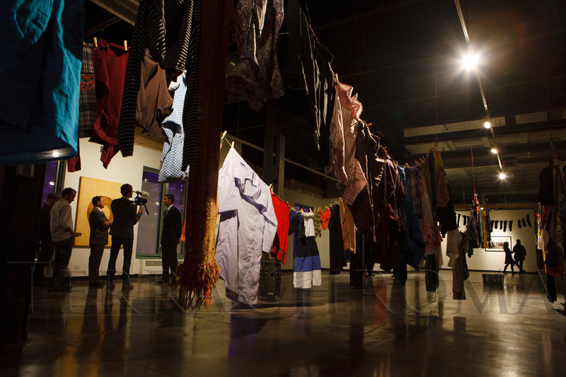 """Leave One, Take One,"" a display of clothing hung on clotheslines, in the third-floor gallery space.  LIGHT gala, a ""Grand Re-opening Party"" for the McNichols Building, hosted by Civic Center Conservancy and Arts & Venues Denver, at McNichols Civic Center Building in Denver, Colorado, on Wednesday, Oct. 24, 2012.<br /> Photo Steve Peterson"