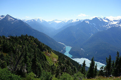 Diablo lake to the southeast. Highway 20 visible on both sides of the lake.