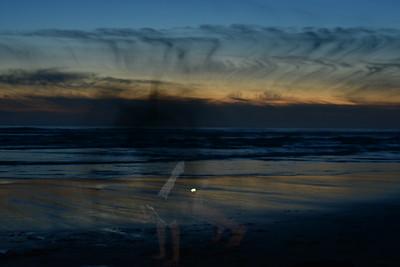 Isaac does a back flip through a sunset.