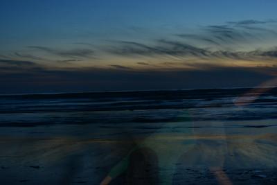 Aiden does a cart wheel through a sunset.