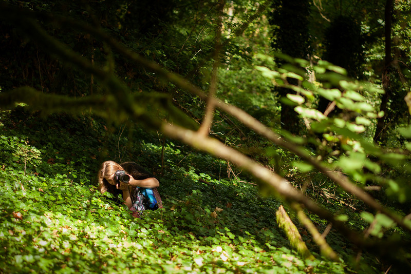 Tracy aims for a shot in the lush foliage.