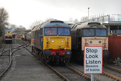 Not the best of shots (I'm really tempted to remove that sign with some photoshop wizardry!) with which to start off the New Year, but I've included it because if you look closeley there are actually three Brush Type 4s visible in this scene, including two of the surviving 'shoves'. 47715 runs past 47703 at Leeming Bar, whilst just visible in the background is 47540 (02/01/2012)