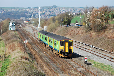 Still carrying the green livery from its previous spell as a London Midland unit, Northern's 150214 negotiates New Mills South Junction from the Marple direction with 2S30 1245 Manchester Piccadilly-Sheffield (29/03/2012)